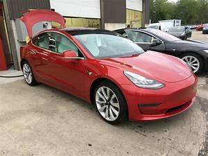 My mom's Tesla model 3 that we got late September. Red, 19 inch wheels, all wheel drive, white ...