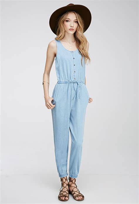 forever 21 denim jumpsuit forever 21 drawstring denim jumpsuit in blue lyst