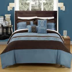 bedroom queen size bed with brown blue and yellow bedding combined grey carpet on wooden floor
