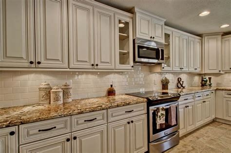 white cabinets  antique mascarello counter top