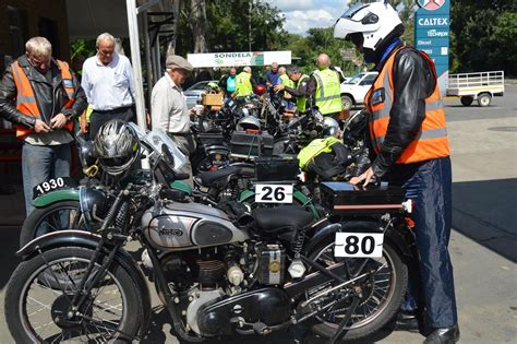 Vintage Bikes Pass Through Town