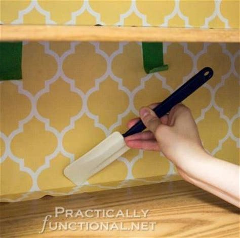wallpaper inside kitchen cabinets 25 best ideas about contact paper cabinets on