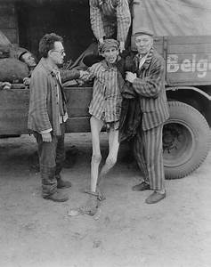 An Emaciated Survivor Is Helped Into A Truck That Will