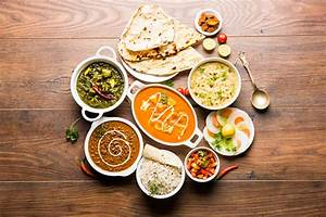 Assorted Indian Food For Lunch Or Dinner Rice Lentils Paneer Dal Makhani Naan Chutney Spices ...