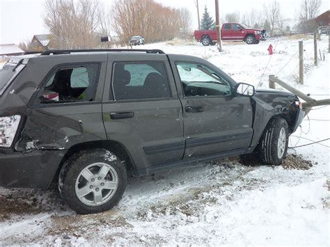 wrecked jeep grand cherokee slick roads cause crash with train local news