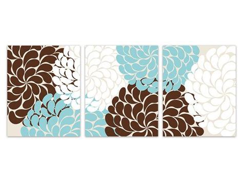 Well, those empty walls in your home are filled with ditch that can of paint and get creative with fun wall decor instead! Home Decor Wall Art Blue and Brown Flower Burst Art Blue and