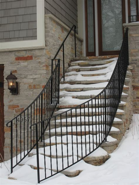 The product creates old world charm with traditional wrought iron design. Exterior Step Railings - O'Brien Ornamental Iron