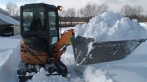 snow removal   excavator     xboom coupler youtube