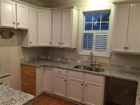 toque white  day kitchen transformation  cabinet girls