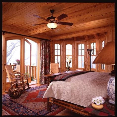Log cabin bedroom. Love the open windows and balcony