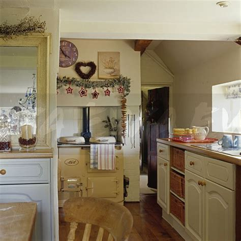Image Cream Aga Oven In Cream Painted Cottage Kitchen