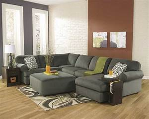 The signature design by ashley glenwood sectional sofa for Sectional sofas room place