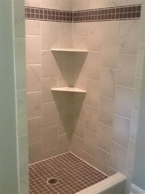 the quot after quot shower is white tile with gray accent same