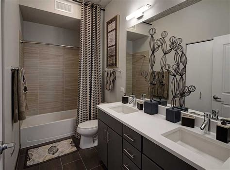 model bathroom featuring porcelain tile bath flooring