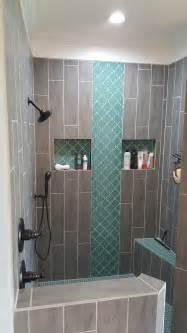 teal arabesque tile accent teal shower floor grey wood