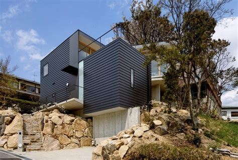 steep slope house plans steep slope house with bookshelf lined interior