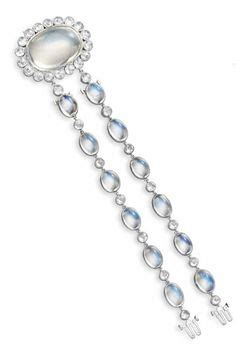 girandole earrings moonstones diamond pendant and sapphire on