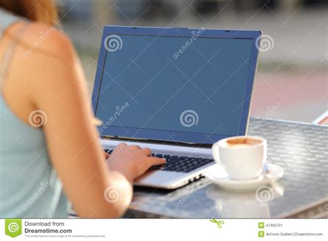Girl Typing On A Laptop And Showing Screen Stock Image