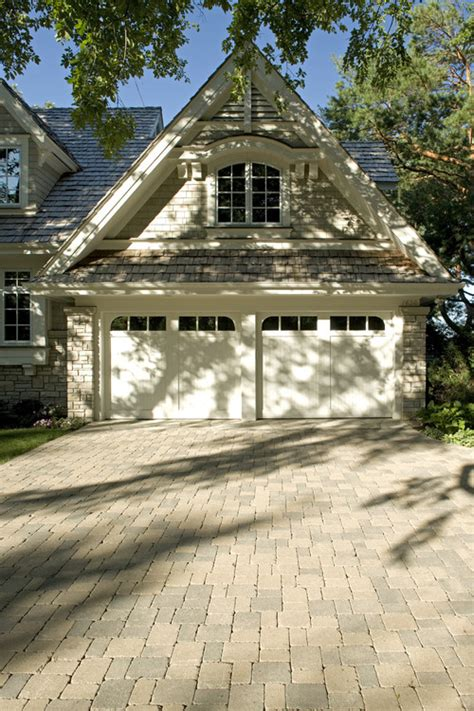 stunning adding a garage to a house ideas custom built house with paver brick driveway