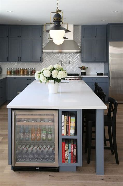 kitchen island with refrigerator steel gray kitchen island with glass beverage fridge next to cookbook shelves contemporary