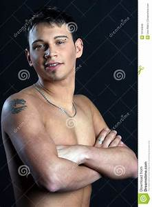 Young Man With Tattoo On Arm Stock Photo