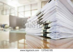 Pile Of Unfinished Documents On Office Desk, Stack Of ...