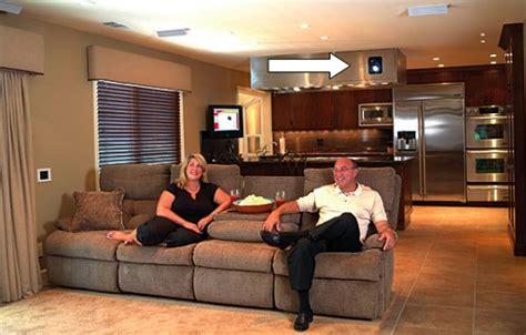 Projector innovator Sam Runco and his wife Lori enjoy the