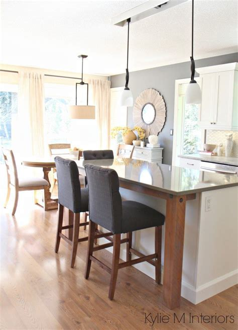 Open layout kitchen and dining room. gray quartz, rustic