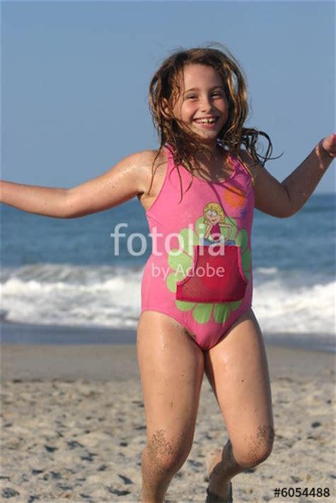 girl jumping   beach stock photo  royalty