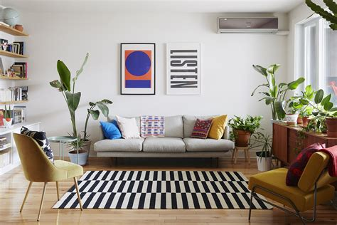 Here, a small section of a mark out a living space with an overhanging pendant light and carefully positioned round coffee table. How to decorate a living room without a coffee table - TopsDecor.com