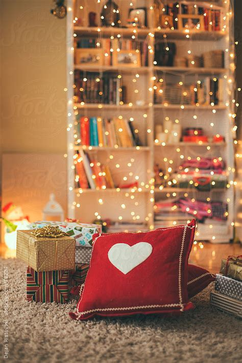 living room decorated with christmas lights and presents