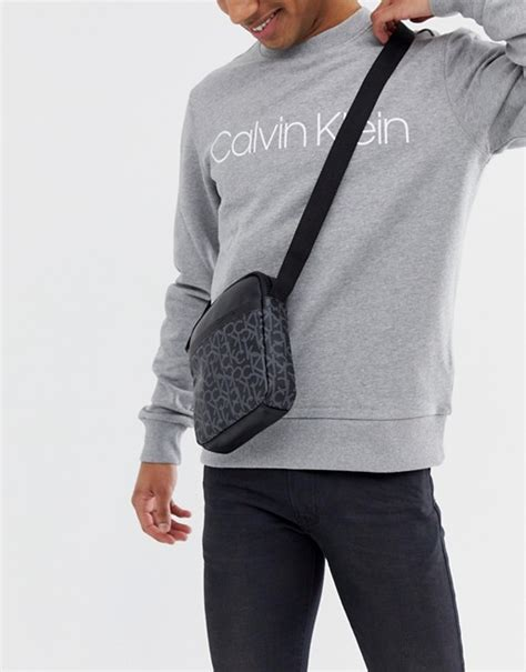 calvin klein ck monogram flight bag  black asos