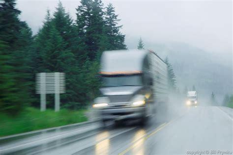 blurred transport truck   rain