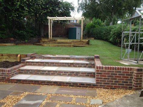 brick tiered steps complemented  paving slabs