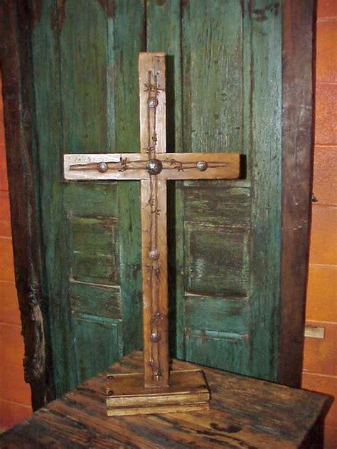 rustic wood barbed wire pedestal cross  celebrate