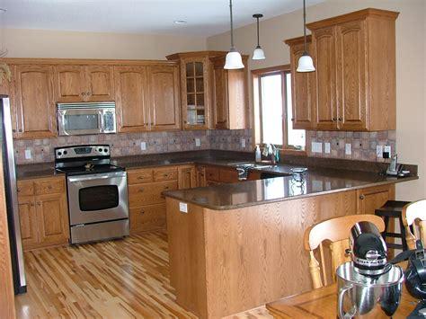 black granite counter oak hickory oak wood kitchen