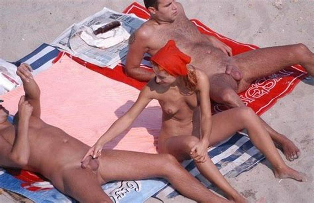 #Couple #Of #Nudists #Caught #Fooling #Naked #In #The #Surf