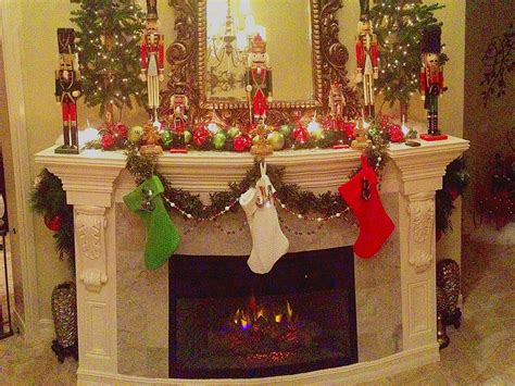 fireplace mantle trees nutcrackers bubblelights hearth
