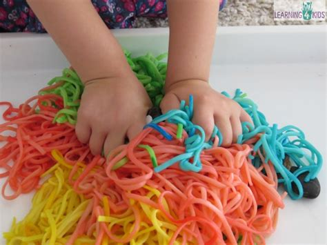 list of sensory play activities amp ideas learning 4 690 | Sensory activities for kids using spaghetti spaghetti worms in a bucket