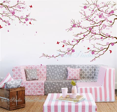 You do it yourself, as you will get own satisfaction, the cost is also much less, the cherry blossom tree wall decals is the best solution to get. Cherry blossom tree wall decals with butterfly wall by ChinStudio