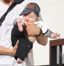 Josh Duhamel and giggling son Axl rock matching headgear ...