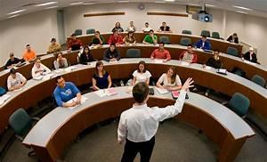 fisheye photograph of professor in college classroom