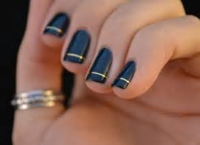 Simple black nail art with gold ring design from
