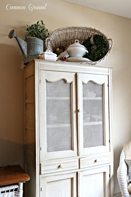 Decorating Ideas Top Of Armoire by Common Ground Ideas On Styling A Cabinet Or Cupboard Top