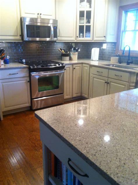 Cabinets: vanilla paint, charcoal glaze. Viatera Quartz