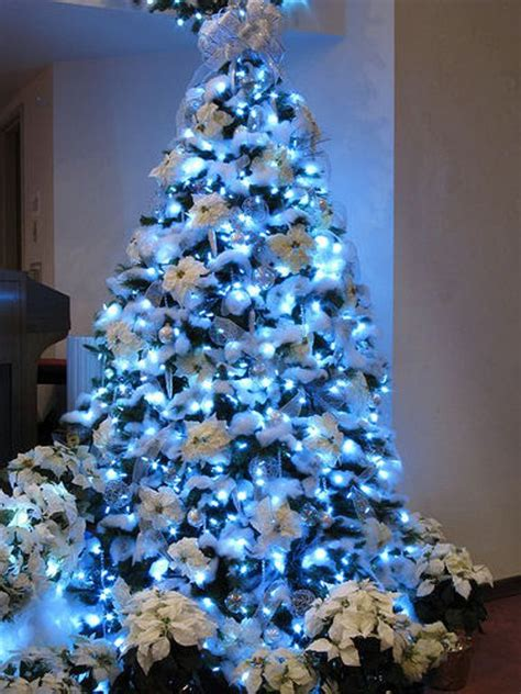 white christmas tree with blue lights 30 traditional and unusual christmas tree décor ideas