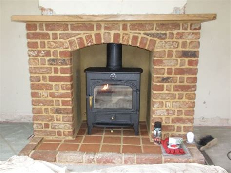 clearview vision wood burning stove with brick arch shelf and terracotta tile hearth pete