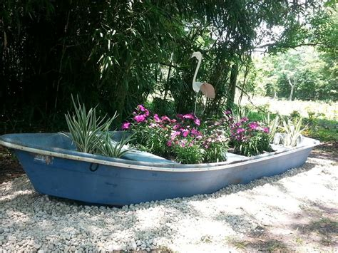 Old Boat Repurpose by Repurposed Boat As Planter For Yard Gardening