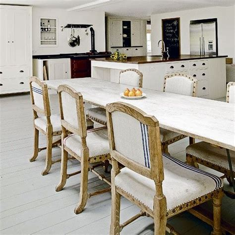 white kitchen chairs open plan kitchen with neutral wood flooring large white