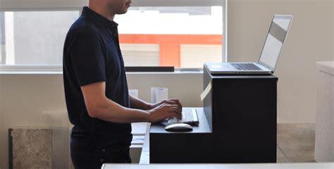 cardboard stand up desk hootsuite founder creates 25 cardboard stand up desk